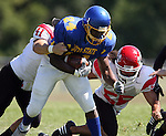 MADISON, SD - AUGUST 30: Te'Jon Sorrell of Dakota State University is brought down from behind by Chris Ehoff #41, and William Gammage #55 of Bacone College in the second quarter of their game Saturday afternoon at Trojan Field in Madison. (photo by Dave Eggen/Inertia)