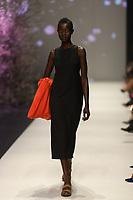Melbourne, September 7, 2018 - A model wearing Alpha 60 walks at the Town Hall Runway Seven show in Melbourne Fashion Week in Melbourne, Australia. Photo Sydney Low