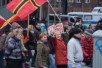 """Etwa 2.000 rechtsradikale Menschen demonstrierten am Samstag den 12. Maerz 2016 in Berlin unter dem Motto """"Merkel muss weg!"""" gegen Angela Merkel, gegen Fluechtlinge und fuer """"Das deutsche Vaterland"""".<br /> Bis auf wenige Ausnahmen waren angereisten Teilnehmer Neonazis und Hooligans, NPD-, Pediga- und AfD-Mitglieder.<br /> Aufgerufen zu dem Aufmarsch hatten die Hooligan-Gruppen """"Buendnis fuer Deutschland"""" und """"Buendnis fuer Berlin"""".<br /> Im Bild: Ein Teilnehmer haelt ein Schil mit der Aufschrift """"Merkel muss weg"""", eine andere Aufmarschteilnehmerin poebelt mit erhobenem Mittelfinger.<br /> 12.3.2016, Berlin<br /> Copyright: Christian-Ditsch.de<br /> [Inhaltsveraendernde Manipulation des Fotos nur nach ausdruecklicher Genehmigung des Fotografen. Vereinbarungen ueber Abtretung von Persoenlichkeitsrechten/Model Release der abgebildeten Person/Personen liegen nicht vor. NO MODEL RELEASE! Nur fuer Redaktionelle Zwecke. Don't publish without copyright Christian-Ditsch.de, Veroeffentlichung nur mit Fotografennennung, sowie gegen Honorar, MwSt. und Beleg. Konto: I N G - D i B a, IBAN DE58500105175400192269, BIC INGDDEFFXXX, Kontakt: post@christian-ditsch.de<br /> Bei der Bearbeitung der Dateiinformationen darf die Urheberkennzeichnung in den EXIF- und  IPTC-Daten nicht entfernt werden, diese sind in digitalen Medien nach §95c UrhG rechtlich geschuetzt. Der Urhebervermerk wird gemaess §13 UrhG verlangt.]"""