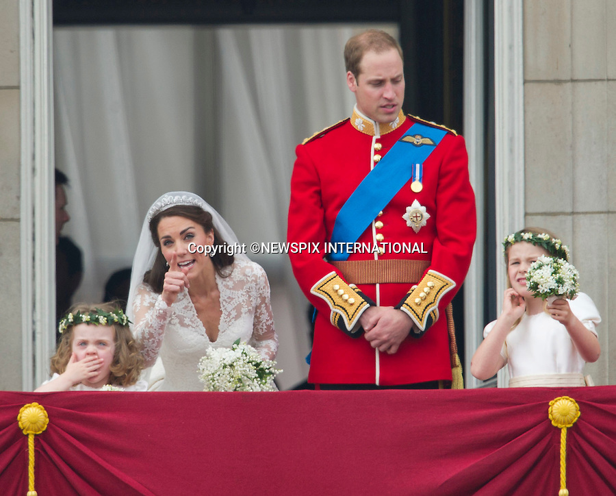 """PRINCE WILLIAM AND CATHERINE MIDDLETON .make an appearance on the balcony of Buckingham Palace, London_29/04/2011.Mandatory Photo Credit: ©Dias/Newspix International..**ALL FEES PAYABLE  TO: """"NEWSPIX INTERNATIONAL""""**..PHOTO CREDIT MANDATORY!!: NEWSPIX INTERNATIONAL(Failure to credit will incur a surcharge of 100% of reproduction fees)..IMMEDIATE CONFIRMATION OF USAGE REQUIRED:.Newspix International, 31 Chinnery Hill, Bishop's Stortford, ENGLAND CM23 3PS.Tel:+441279 324672  ; Fax: +441279656877.Mobile:  0777568 1153.e-mail: info@newspixinternational.co.uk"""