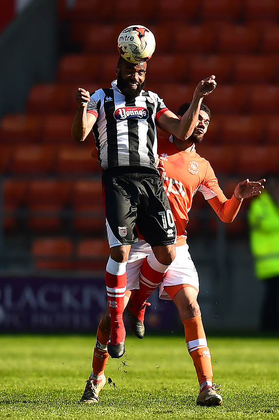 Grimsby Town's Dominic Vose beats Blackpool's Kelvin Mellor to the ball<br /> <br /> Photographer Richard Martin-Roberts/CameraSport<br /> <br /> The EFL Sky Bet League Two - Blackpool v Grimsby Town - Saturday 8th April 2017 - Bloomfield Road - Blackpool<br /> <br /> World Copyright &copy; 2017 CameraSport. All rights reserved. 43 Linden Ave. Countesthorpe. Leicester. England. LE8 5PG - Tel: +44 (0) 116 277 4147 - admin@camerasport.com - www.camerasport.com