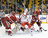Peter Starrett (Harvard - 14), Ryan Carroll (Harvard - 35), Joe Pereira (BU - 6), Danny Biega (Harvard - 9) - The Harvard University Crimson defeated the Boston University Terriers 5-4 in the 2011 Beanpot consolation game on Monday, February 14, 2011, at TD Garden in Boston, Massachusetts.