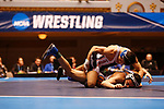 CLEVELAND, OH - MARCH 10: Carlos Fuentez, of Wheaton wrestles Jay Albis, of Johnson & Wales, in the 125 weight class during the Division III Men's Wrestling Championship held at the Cleveland Public Auditorium on March 10, 2018 in Cleveland, Ohio. Albis went on to win first place in the 125 weight class. (Photo by Jay LaPrete/NCAA Photos via Getty Images)