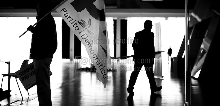 Some Partito Democratico's supporters - the Italian left-wing Party - hold flags before the beginning of Matteo Renzi's speech during a political campaign convention for the Italian government elections in Turin, April 12, 2014.