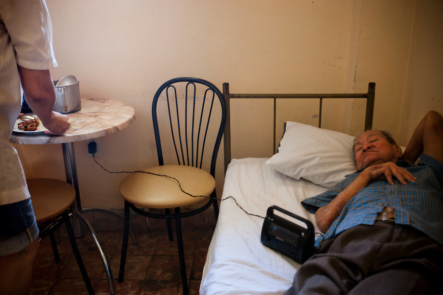 An elderly Chinese immigrant awaits lunch in his bedroom of the Residencia del Anciano Chino, on Saturday, April 26, 2008. Many aging Chinese immigrants have not seen their family in China in over 50 years. .