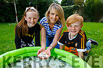 Hannah, Rachel and Finn McKinsey from Caherslea, babysitting their tadpoles before they release them back in to the wilds in Tonevane.