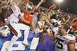 Auburn players celebrate with fans their 37-34 win over UK at Commonwealth Stadium on Saturday, Oct. 9, 2010. Photo by Scott Hannigan | Staff
