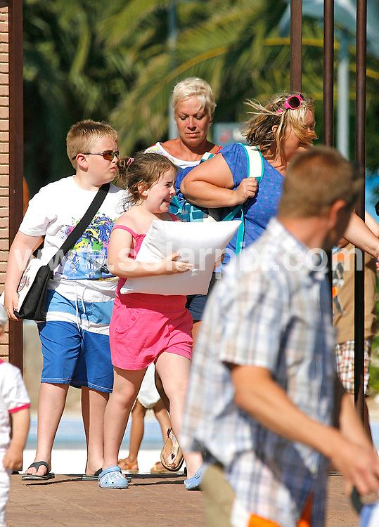 **ALL ROUND EXCLUSIVE PICTURES FROM SOLARPIX.COM**                                             **WORLDWIDE SYNDICATION RIGHTS**                                                                                  Waterloo Road star Denise Welch spent the day at  Aqua Land Water Park in Fuengirlola on The Costa Del Sol with Man Utd star Wes Brown's wife Leanne Wassell and friends this week. She has been on a one week break with Dancing on Ice star Matt Evers..Althougfh Denise works with kids in her job playing a teacher called Steph Haydock on the BBC drama Waterloo Road, she looked fed up at having to line up at the back of a queue of children to collect her bags from the cloakroon before hometime.                                                                            This pic:                                                                                              JOB REF:   13436     AB1       DATE:  09.06.11                                                          **MUST CREDIT SOLARPIX.COM OR DOUBLE FEE WILL BE CHARGED**                                                                      **MUST AGREE FEE BEFORE ONLINE USAGE**                               **CALL US ON: +34 952 811 768 or LOW RATE FROM UK 0844 617 7637**