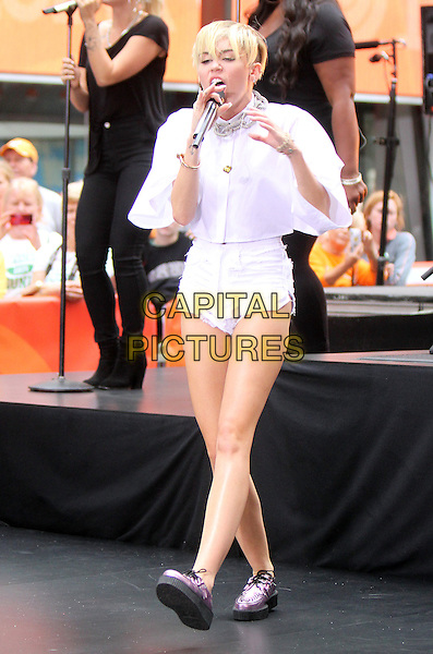 Miley Cyrus <br /> Performs at NBC's Today Show Concert Series at Rockefeller Plaza in New York City, NY., USA.<br /> October 7th, 2013<br /> on stage in concert live gig performance performing music full length white shirt jean denim cut off shorts singing <br /> CAP/MPI/RW<br /> &copy;RW/ MediaPunch/Capital Pictures
