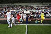 Pictured: Ashley Williams (L) and Tim Krul (R) lead their teams to the pitch Saturday 15 August 2015<br />
