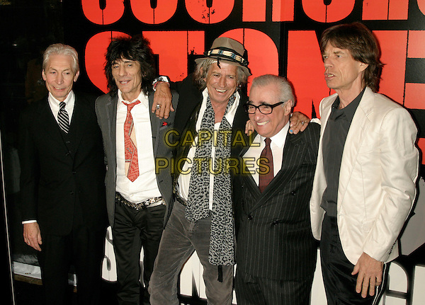 "THE ROLLING STONES - RONNIE WOOD, CHARLIE WATTS, KEITH RICHARDS, MARTIN SCORSESE & MICK JAGGER .New York Premiere of ""Shine A Light"" at the Ziegfeld Theater, New York, NY, USA..March 30th, 2008.half length black white grey gray pinstripe suit jacket hat leopard print scarf arm over shoulders glasses .CAP/LNC/TOM.©TOM/LNC/Capital Pictures."