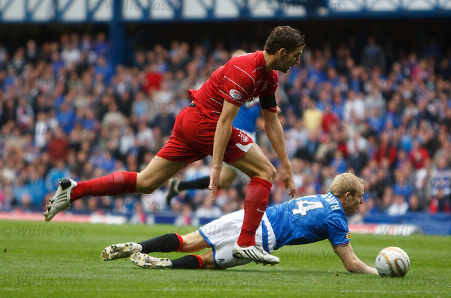 Steven Naismith goes down on the edge of the box under a Charlie Mulgrew challenge