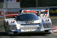 MIAMI, FL - MARCH 2: Bruce Leven's Bridgestone/Bayside Porsche 962 109 driven by Bob Wollek of France and Paolo Barilla of Italy lifts a left front wheel while cornering during the Lowenbrau Grand Prix of Miami IMSA GTP race on the temporary street circuit in Bicentennial Park in Miami, Florida, on March 2, 1986. (Photo by Bob Harmeyer)