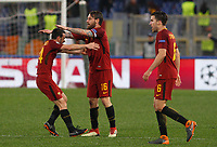 Roma players, from left, Alessandro Florenzi, Daniele De Rossi and Kevin Strootman celebrate at the end of the Uefa Champions League round of 16 second leg soccer match between Roma and Shakhtar Donetsk at Rome's Olympic stadium, March 13, 2018. Roma won. 1-0 to join the quarter finals.<br /> UPDATE IMAGES PRESS/Riccardo De Luca