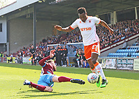Blackpool's Marc Bola rides the challenge from Scunthorpe United's Kevin Van Veen<br /> <br /> Photographer David Shipman/CameraSport<br /> <br /> The EFL Sky Bet League One - Scunthorpe United v Blackpool - Friday 19th April 2019 - Glanford Park - Scunthorpe<br /> <br /> World Copyright © 2019 CameraSport. All rights reserved. 43 Linden Ave. Countesthorpe. Leicester. England. LE8 5PG - Tel: +44 (0) 116 277 4147 - admin@camerasport.com - www.camerasport.com