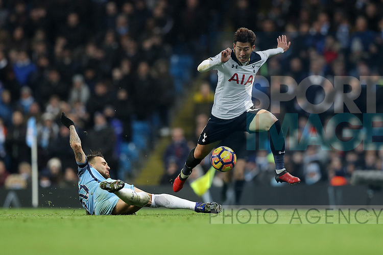 Son Heung-Min of Tottenham Hotspur jumps over Nicolas Otamendi of Manchester City during the Premier League match at Etihad Stadium, Manchester. Picture date: January 21st, 2017.Photo credit should read: Lynne Cameron/Sportimage