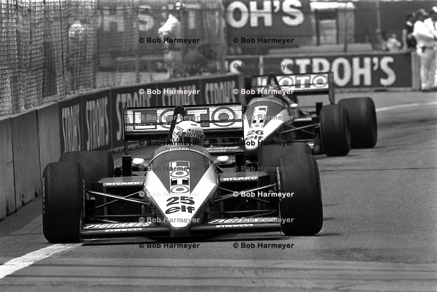 DETROIT, MI - JUNE 22: Teammates René Arnoux of France and Jacques Laffite of France drive their Ligier JS27/Renault EF4B entries during the Detroit Grand Prix FIA Formula One World Championship race on the Detroit Street Circuit in Detroit, Michigan, on June 22, 1986.