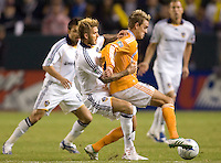 Houston Dynamo's Stuart Holden is chased down by LA Galaxy's David Beckham during  the MLS  Western Conference Final. The LA Galaxy defeated the Houston Dynamo 2-1 to win the MLS Western Conference Final at Home Depot Center stadium in Carson, California on Friday November 13, 2009.....