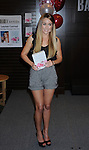 """LOS ANGELES, CA. - February 18: Lauren Conrad poses during the signing for her second book """"Sweet Little Lies"""" at Barnes and Noble Booksellers at The Grove on February 18, 2010 in Los Angeles, California."""