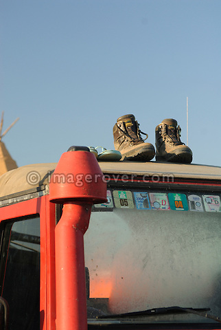 Germany, Bad Kissingen, Allrad Messe, 15-18.06.2006. Shoes on top of a Land Rover at early morning. --- No releases available. Automotive trademarks are the property of the trademark holder, authorization may be needed for some uses.
