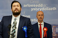 Pictured: Geraint Davies (R) stands while James Price for the Conservatives is addressing the audience. Friday 13 December 2019<br /> Re: Ballots count at the Leisure Centre in Swansea, Wales, UK.