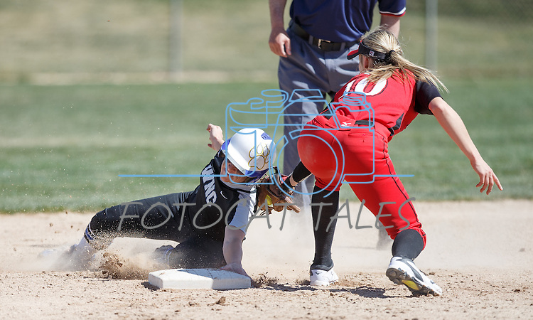 Western Nevada's Makaylee Jaussi tries to avoid the tag at second against Colorado North Western at Edmonds Sports Complex Carson City, Nev., on Friday, March 18, 2016.<br /> Photo by Jeff Mulvihill, Jr.