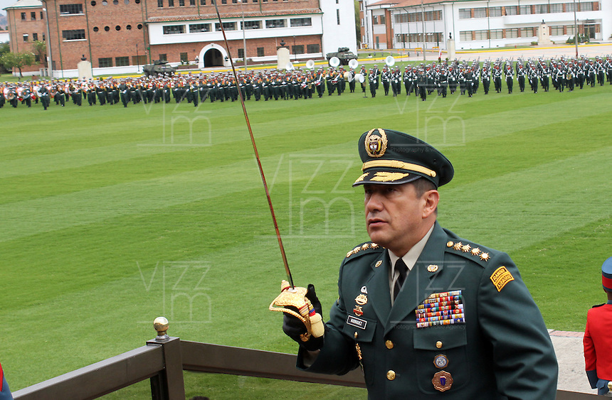 BOGOTA -COLOMBIA. 21-02-2014. El general Juan Pablo Rodriguez toma posesion como nuevo comandante de las Fuerzas Militares de Colombia. Con la presencia del presidente Juan Manuel Santos y el ministro de defensa Juan Carlos Pinzon tomaron posesion de sus nuevos cargos los generales Juan Pablo Rodriguez nuevo comandante de las Fuerzas Militares de Colombia, general Javier Florez nuevo comandante del Estado Mayor Conjunto y el general Jaime Lasprilla comandante del Ejercito Nacional ceremonia celebrada en la Escuela Jose Maria Cordova. / With the presence of President Juan Manuel Santos and Defense Minister Juan Carlos Pinzon took possession of their new positions general Juan Pablo Rodriguez new commander of the Military Forces of Colombia, General Javier Florez new comadante of the Joint Chiefs and General Jaime Lasprilla army commander ceremony at the Jose Maria Cordova School.  Photo: VizzorImage/ Felipe Caicedo / Staff