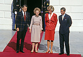 Washington, DC - November 9, 1985 -- United States President Ronald Reagan and first lady Nancy Reagan greet Princess Diana and Prince Charles at the White House in Washington, DC on November 9, 1985<br /> Credit: Howard L. Sachs / CNP