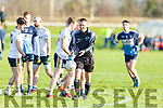Referee Rory Hickey advances the ball due to dissent as he officiates the I T Tralee v Ulster University game in the 1st round of the Sigerson Cup Senior football in John Mitchells on Sunday.