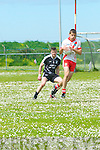 An Ghaeltacht Sean Micheal Ó Conchúir in possession of the ball closely watched by Ardfert Rory Horgan during the CSFL Div. 3 match at Gallarus on Sunday afternoon.