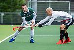 AMSTELVEEN - Diede van Puffelen (R'dam) met Justin Reid-Ross (Adam)  tijdens de hoofdklasse competitiewedstrijd heren, AMSTERDAM-ROTTERDAM (2-2). COPYRIGHT KOEN SUYK