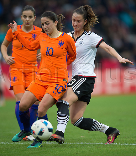 25.10.2016. Aaeln, Germany.  Netherland's Danielle van de Donk (L) and Germany's Sara Daebritz challenge for the ball during the women's international soccer match between Germany and the Netherlands