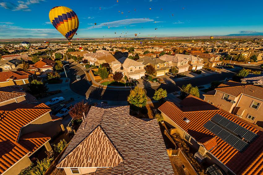 Hot air balloons landing in a residential area during the Albuquerque International Balloon Fiesta, Albuquerque, New Mexico USA.