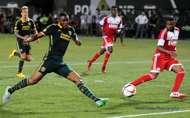 Jun 6, 2015; Portland, OR, USA; Portland Timbers forward Fanendo Adi (9) scores his second goal during the second half of the game against the New England Revolution at Providence Park. The Timbers won the game 2-0. Mandatory Credit: Steve Dykes-USA TODAY Sports