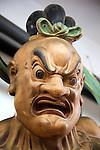 Close up of angry Buddha face Gangaramaya Buddhist Temple, Colombo, Sri Lanka, Asia