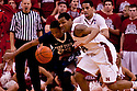 11 January 2012: Dylan Talley #24 of the Nebraska Cornhuskers and Tim Frazier #23 of the Penn State Nittany Lions go for the ball during the second half at the Devaney Sports Center in Lincoln, Nebraska. Nebraska defeated Penn State 70 to 58.