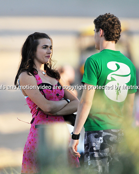 2nd July, 2014 SYDNEY AUSTRALIA<br /> Non EXCLUSIVE <br /> Pictured, Demi Harman kisses Alec Snow whilst Andrew Morley watches during a shoot at the location for Summer Bay on Sydneys Palm Beach, NSW<br /> <br /> *No internet without clearance*.MUST CALL PRIOR TO USE +61 2 9211-1088. Matrix Media Group.Note: All editorial images subject to the following: For editorial use only. Additional clearance required for commercial, wireless, internet or promotional use.Images may not be altered or modified. Matrix Media Group makes no representations or warranties regarding names, trademarks or logos appearing in the images.