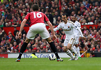 Pictured: (L-R) Michael Carrick, Leon Britton. <br /> Sunday 12 May 2013<br /> Re: Barclay's Premier League, Manchester City FC v Swansea City FC at the Old Trafford Stadium, Manchester.