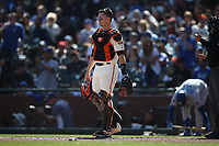 SAN FRANCISCO, CA - SEPTEMBER 28:  Buster Posey #28 of the San Francisco Giants works behind the plate against the Los Angeles Dodgers during the game at Oracle Park on Saturday, September 28, 2019 in San Francisco, California. (Photo by Brad Mangin)