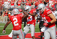 Ohio State Buckeyes running back Jordan Hall (2) congratulates quarterback Kenny Guiton (13) after Guiton scored a touchdown during the second quarter of the NCAA football game against San Diego State at Ohio Stadium in Columbus on Sept. 7, 2013. (Adam Cairns / The Columbus Dispatch)