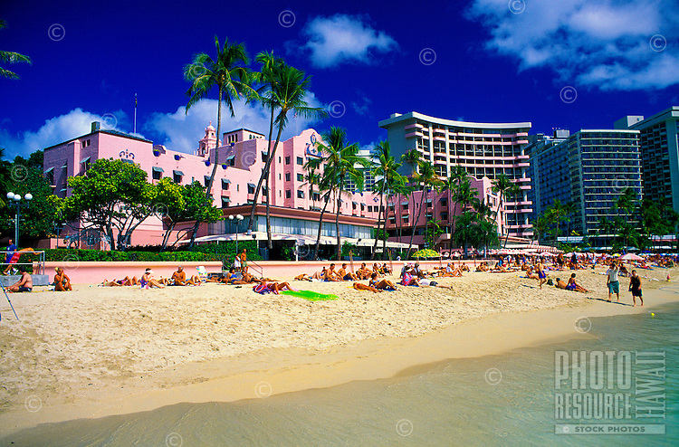 "The beachfront of the fabulous Royal Hawaiian Hotel, or """"pink palace"""", a Waikiki historic landmark."