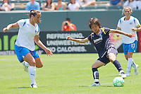 Aya Miyama #8 of the Los Angeles Sol controls the ball in the midfield against the defense of the Boston Breakers during thier WPS game at Home Depot Center on May 10, 2009 in Carson, California.
