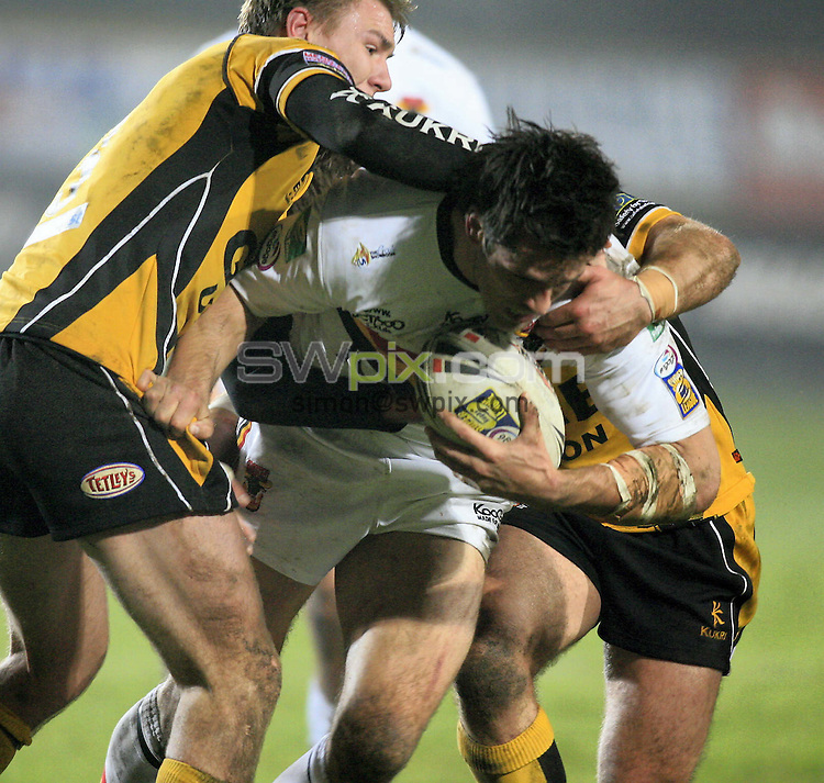Pix: Chris Mangnall/SWpix.com, Rugby League, Carnegie Challenge Cup 4th Round . 30/03/07. Bradford Bulls v Castleford Tigers ....picture copyright>>simon wilkinson>>07811267 706>>....Bradford's Nathan McAvoy tackled by Castleford's Michael Shenton and Chris Charles