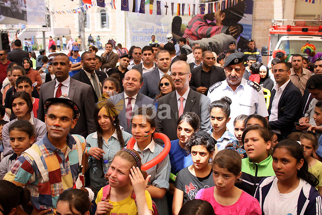 """Palestinian Prime Minister, Rami Hamdallah, participates in a celebration to mark """"Europe Day"""" in the West Bank city of Ramallah on May 7, 2015. Europe Day, also known as Schuman Day, is an annual celebration of peace and unity in Europe and commemorating the historical declaration by French foreign minister Robert Schuman. Photo by Prime Minister Offic"""