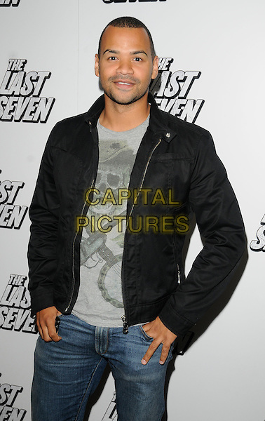 "MICHAEL UNDERWOOD .At ""The Last Seven"" UK Film Premiere, Odeon cinema Covent Garden, London, England, UK, August 24th 2010..half length black jacket grey gray t-shirt jeans skull .CAP/CAN.©Can Nguyen/Capital Pictures."