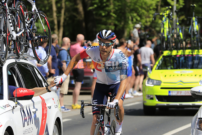 Lawrence Warbasse (USA) IAM Cycling on water bottle duty as the riders pass Grebbeberg Military Cemetery on the route of Stage 2 of the 2016 Giro d'Italia running 190km from Arnhem to Nijmegen, The Nethrerlands. 7th May 2016.<br /> Picture: Eoin Clarke | Newsfile<br /> <br /> <br /> All photos usage must carry mandatory copyright credit (&copy; Newsfile | Eoin Clarke)