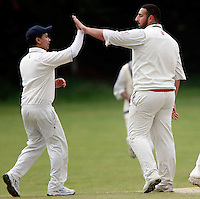 J Azar (R) of Wembley is congratulated after dismissing D Makwana during the Middlesex County Cricket League Division Three game between Hornsey and Wembley at Tivoli Road, Crouch End, London on Sat May 29, 2010