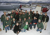 Saturday, Feb. 18, 2006  Anchorage, Alaska. Volunteer Iditarod Airforce pilots and others pose for a group photo at Merrill Field prior to loading straw and musher food bags into Cessna planes headed out to checkpoints along the trail.
