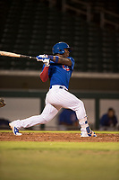 AZL Cubs 1 second baseman Yonathan Perlaza (12) follows through on his swing during an Arizona League game against the AZL Diamondbacks at Sloan Park on June 18, 2018 in Mesa, Arizona. AZL Diamondbacks defeated AZL Cubs 1 7-0. (Zachary Lucy/Four Seam Images)