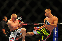 Oct. 29, 2011; Las Vegas, NV, USA; UFC fighter Dennis Siver (left) against Donald Cerrone during a lightweight bout during UFC 137 at the Mandalay Bay event center. Mandatory Credit: Mark J. Rebilas-